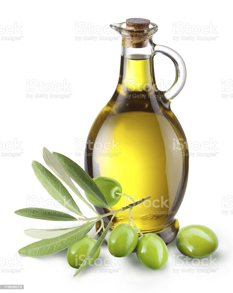 Branch with olives and a bottle of olive oil stock photo