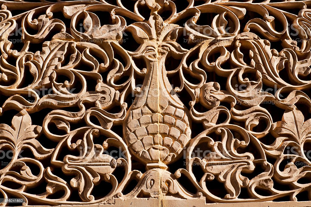 Branches and leaves carved on an old wall stock photo