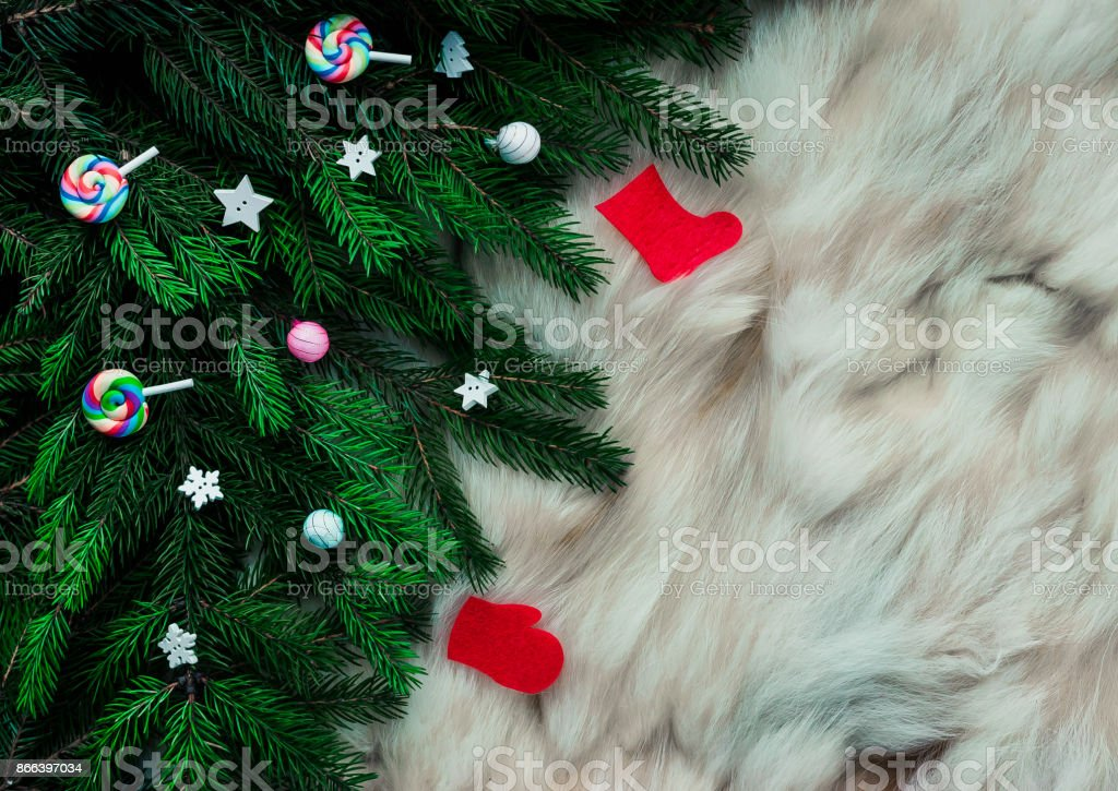 Branches Of A Christmas Tree With Decorations And Lollipops On A