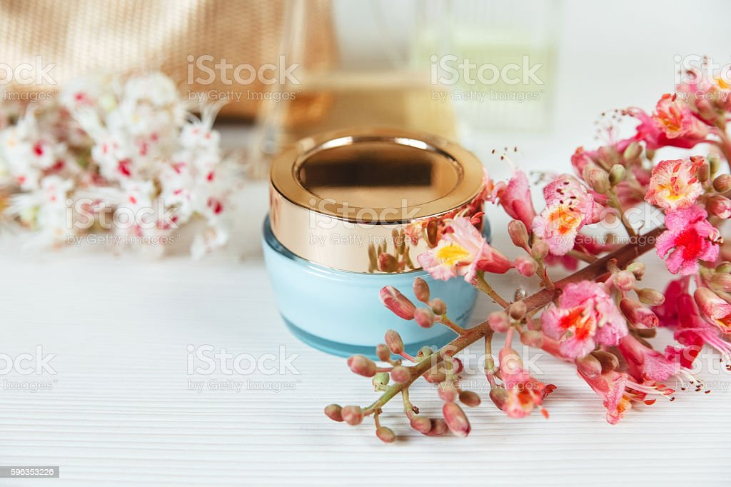 Branches of Chestnut Tree,Bottle Creamю.White Table,Background royalty-free stock photo