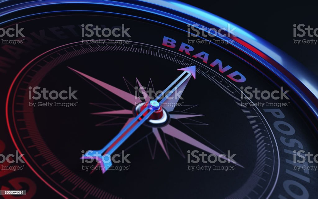Brand Concept: Arrow of A Compass Pointing Brand Text stock photo