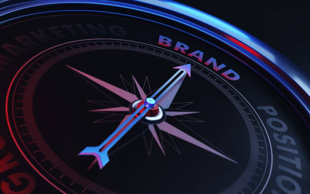 brand concept: arrow of a compass pointing brand text - position stock pictures, royalty-free photos & images