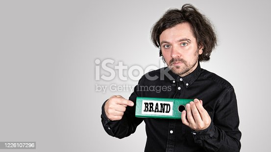 843789992 istock photo Brand concept.  Office binder in the hands of man 1226107296