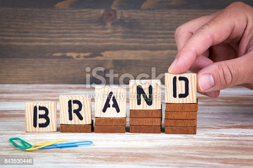 istock Brand concept. Wooden letters on the office desk, informative and communication background 843530446