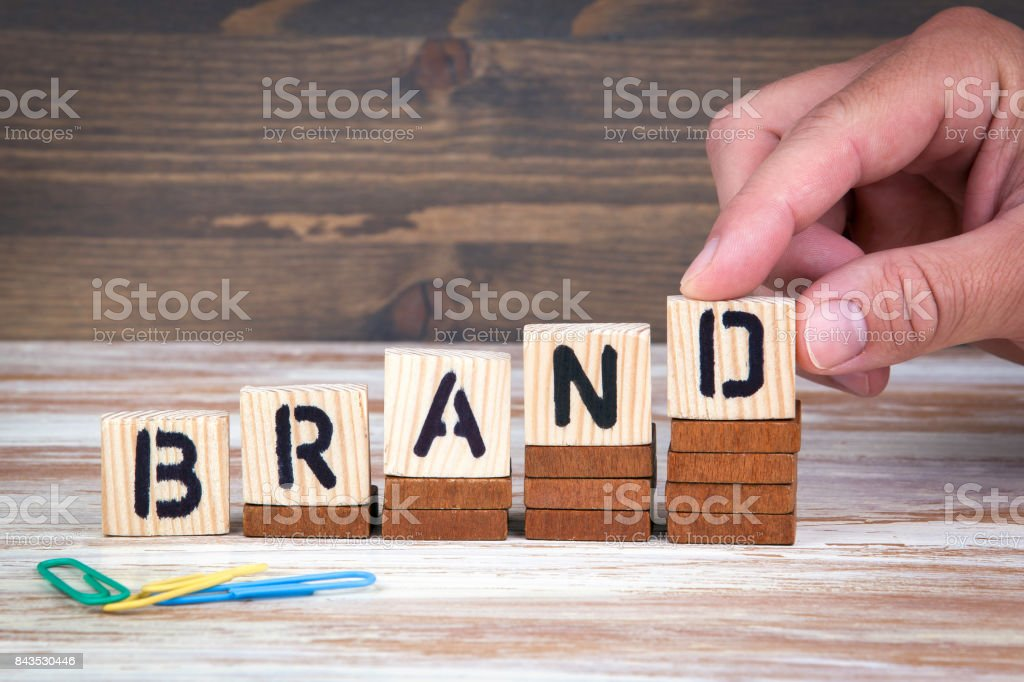 Brand concept. Wooden letters on the office desk, informative and communication background stock photo
