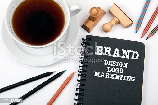 1027533352 istock photo Brand. Design, Logo and Marketing Concept. Black notebook and office supplies 1224323565