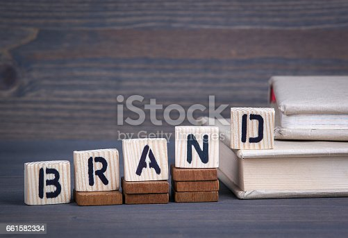 657955676 istock photo Brand from wooden letters. Abstract business and success background 661582334