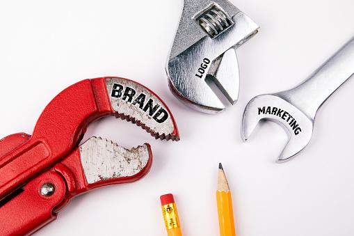 1150734727 istock photo Brand, logo, marketing concept. Plumbing key 1127993769