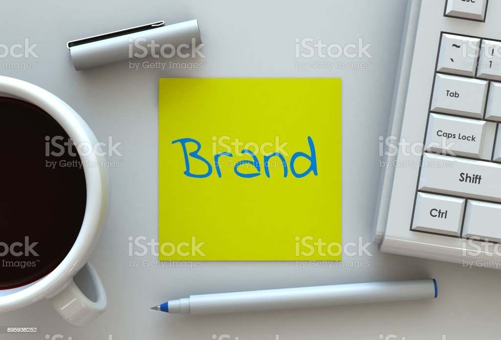 Brand, message on note paper, computer and coffee on table stock photo