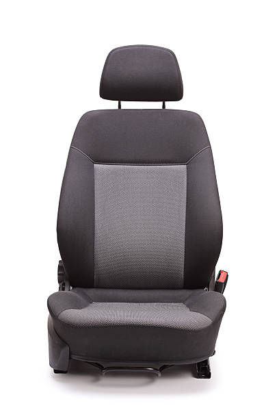 Brand new black car seat Vertical studio shot of a brand new black car seat isolated on white background seat stock pictures, royalty-free photos & images