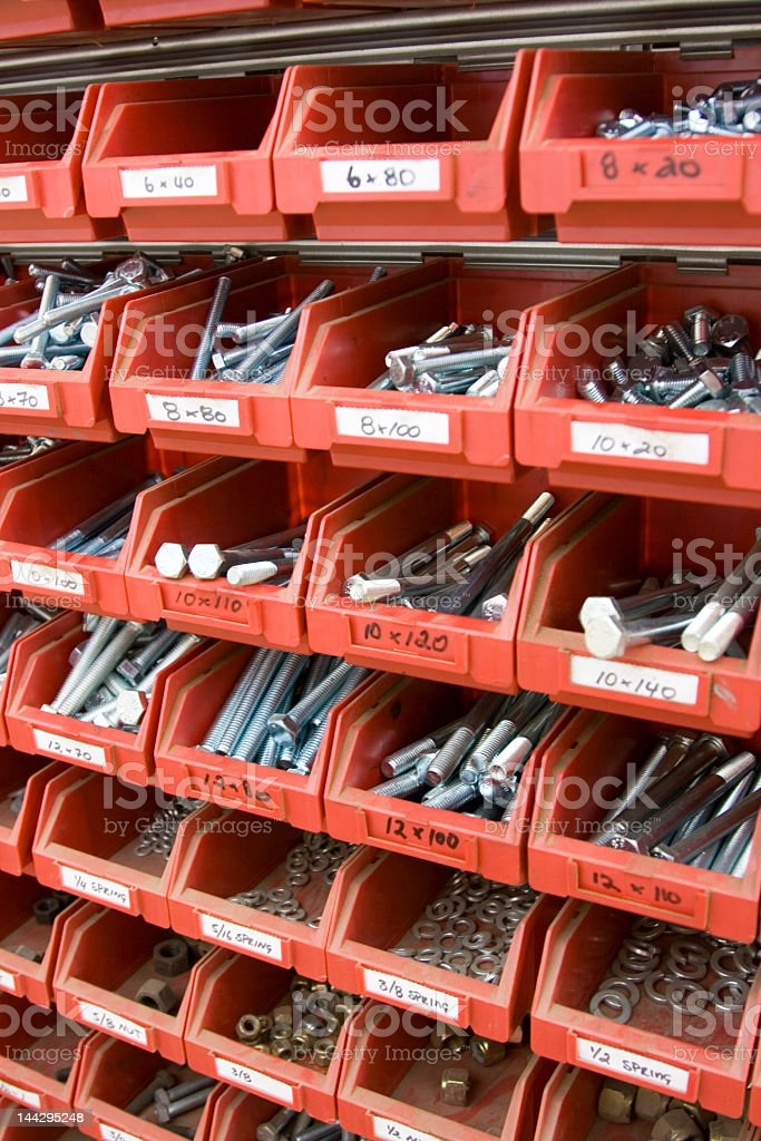 Brand New Bolts and Nuts in Red Workshop Trays royalty-free stock photo