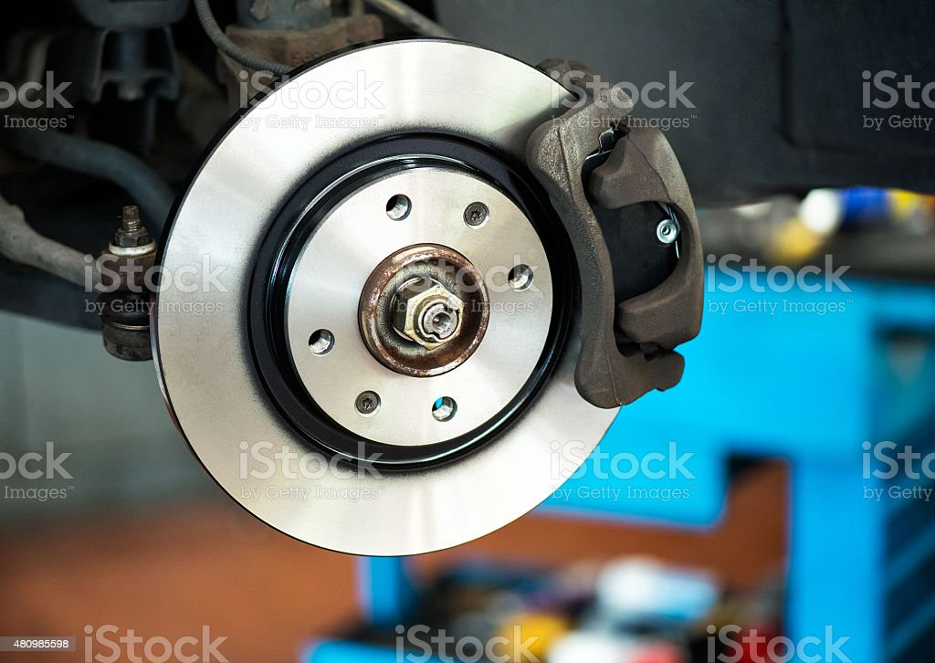 Brand new brake disc on car stock photo