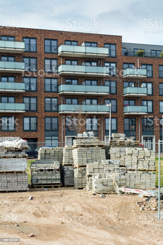 Brand new brown stone  strip apartement building stock photo