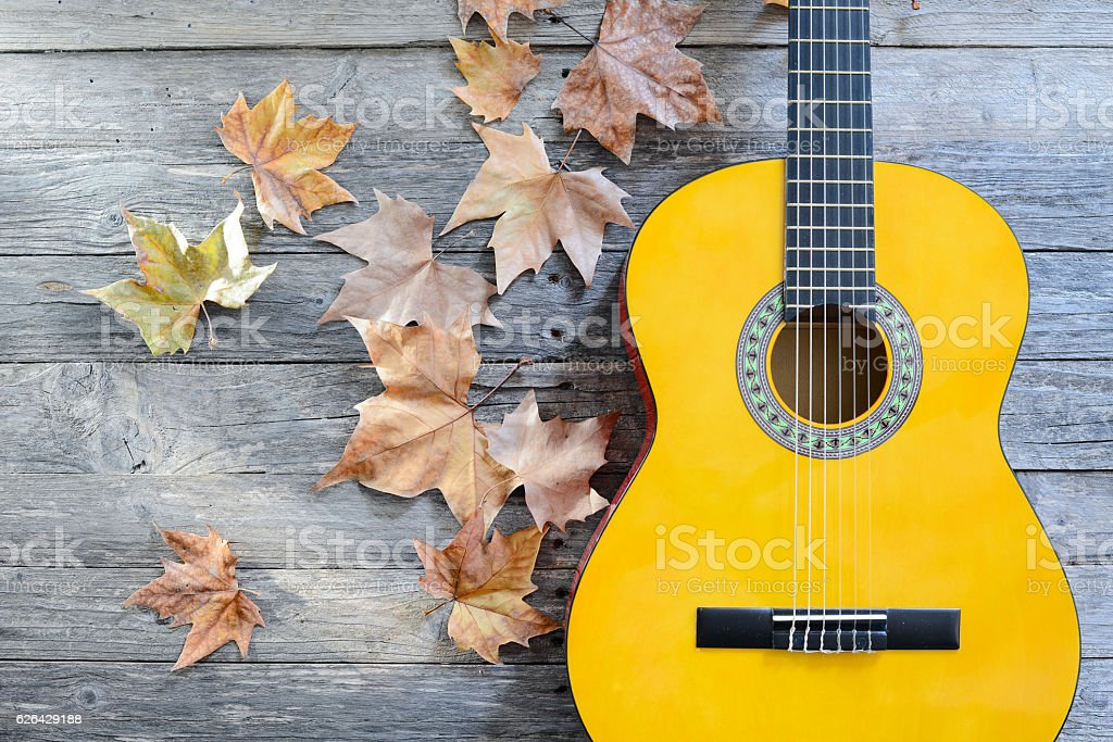 Brand New Classical Guitar On A Old Wooden Plank Background Royalty Free Stock Photo