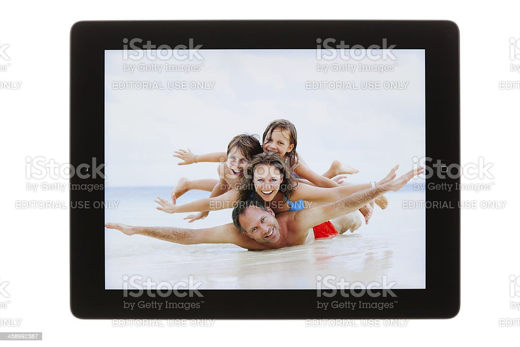 brand new iPad 4 with photograph royalty-free stock photo