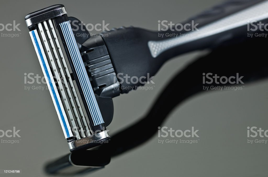 Brand new male razor gray and blue color royalty-free stock photo
