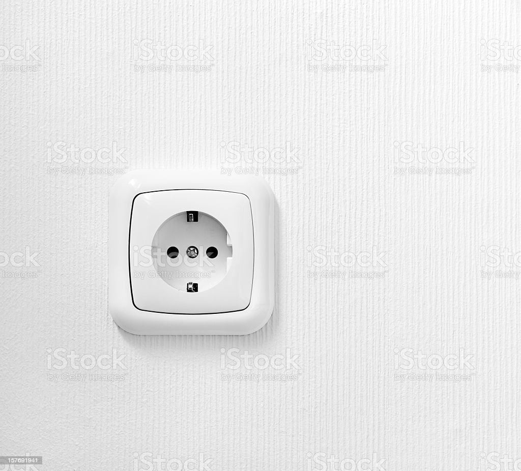 brand new outlet on a white wall stock photo