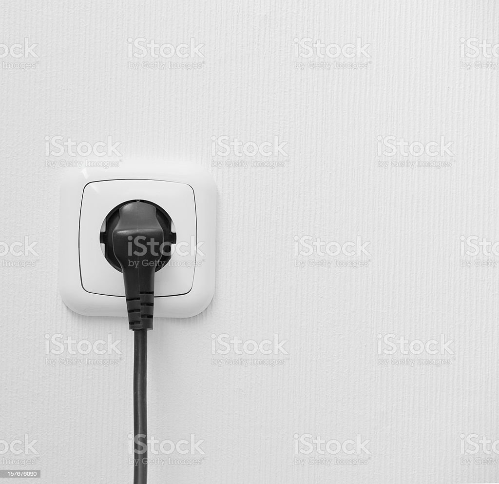 brand new outlet on a white wall with plug stock photo