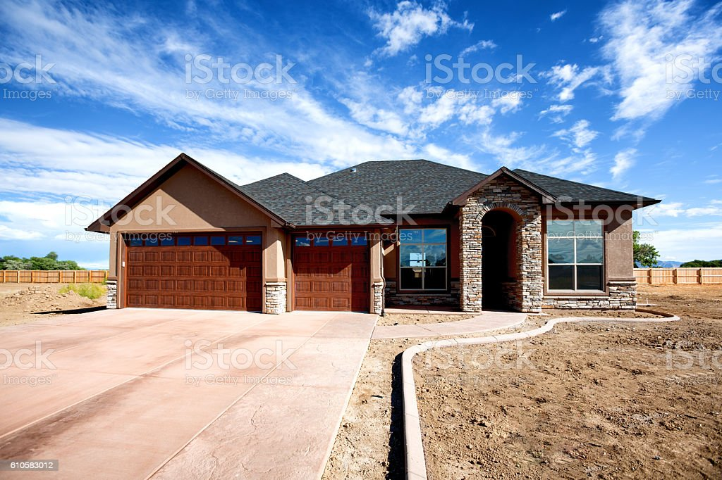 Brand New Ranch Style Stucco And Rock Home Stock Photo - Stucco home style