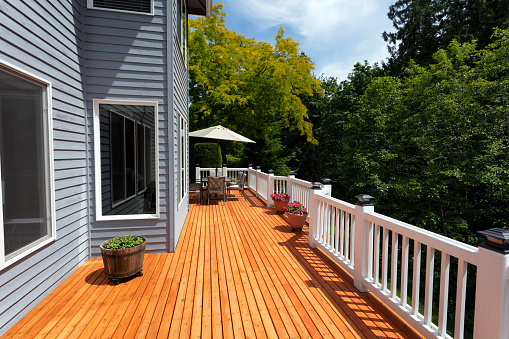 New red cedar outdoor wooden deck during nice weather in horizontal layout