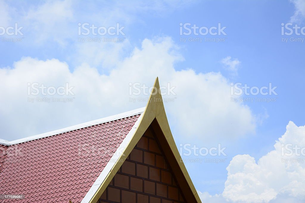 Brand new red rooftop against blue sky background royalty-free stock photo