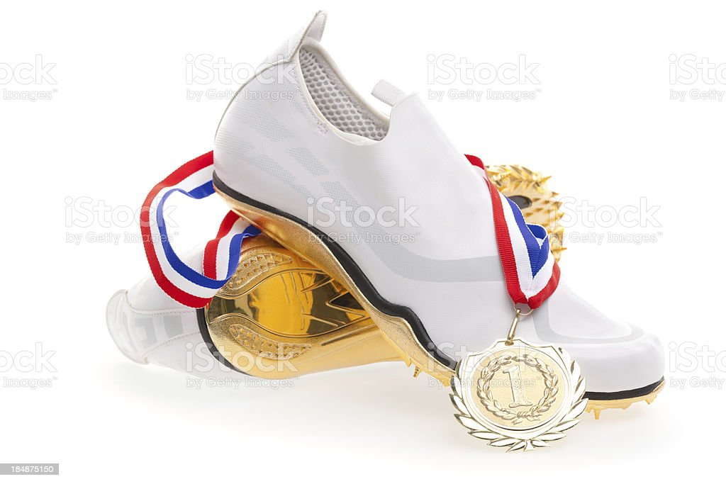 brand new running spikes with gold medal stock photo