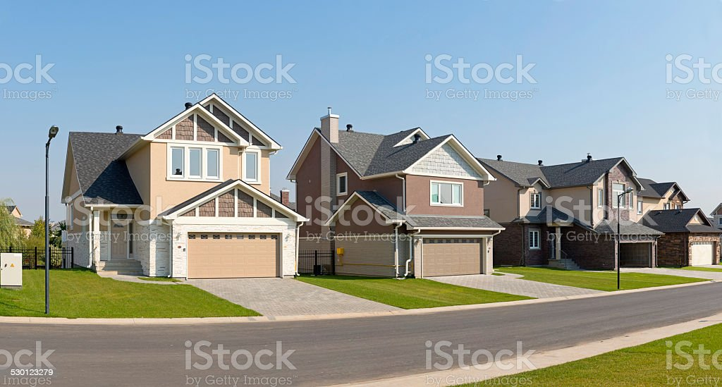 Brand new suburban house in sunny summer afternoon stock photo
