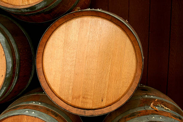 Brand new wine barrel sitting on top of other barrels stock photo