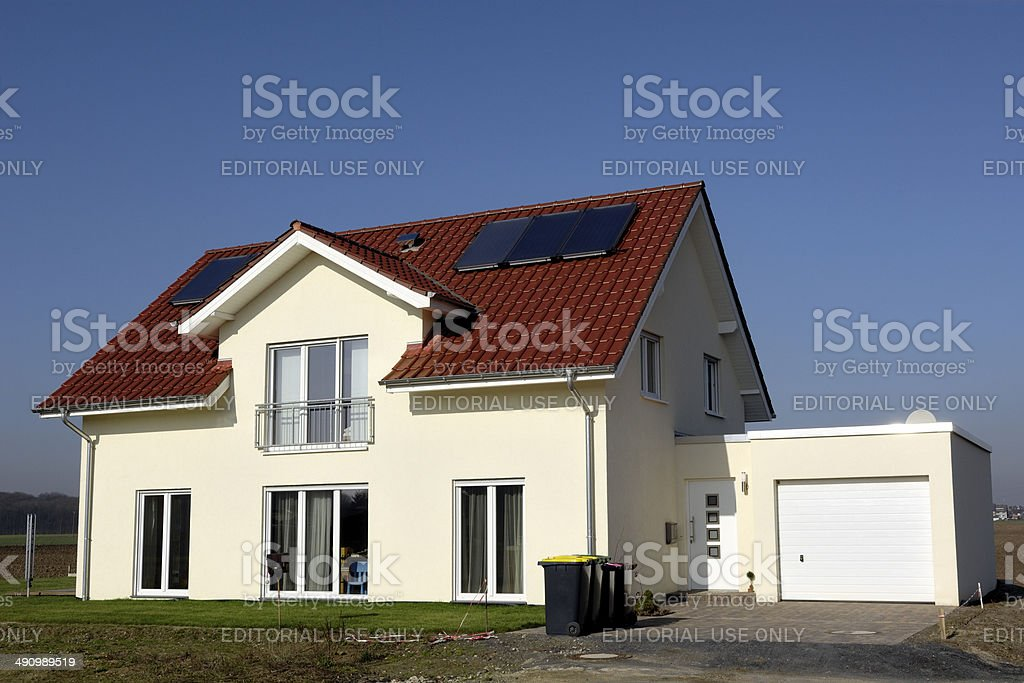 Brand new yellow family house with garage stock photo