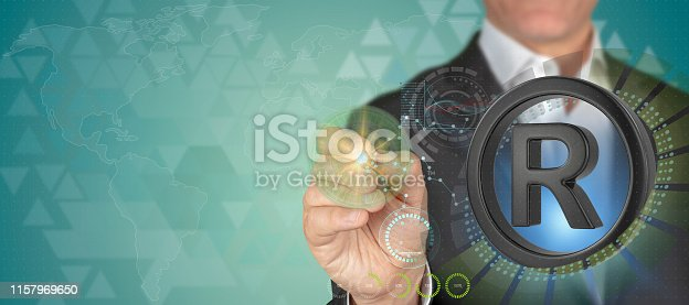 Brand registry concept. Businessman pointing 3D registered trade mark sign object with pen in HUD patterned techno blue background with copy space