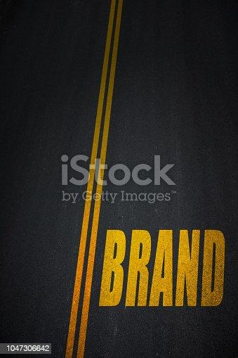 843789992istockphoto Brand text on asphalt road 1047306642
