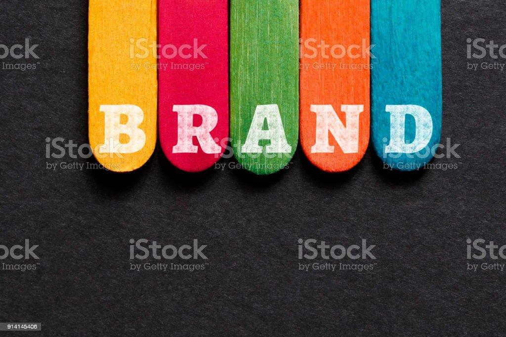 Brand Word on Wood Block stock photo