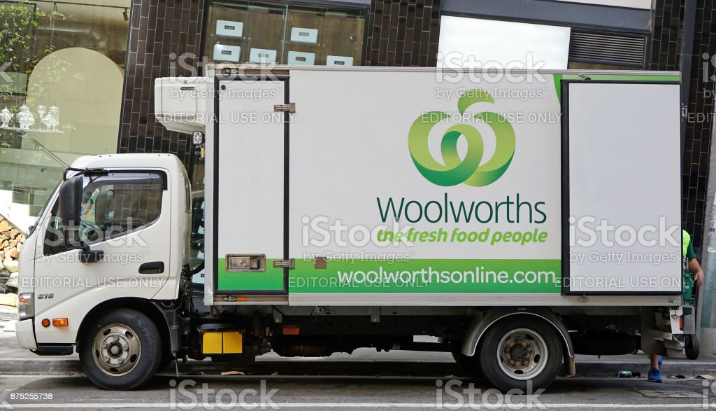 Branded lorry from a well-known Australian supermarket chain Woolworths is making a grocery delivery stock photo