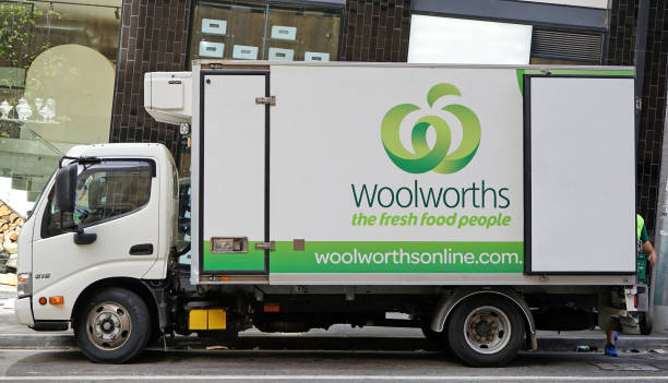 branded lorry from a well-known australian supermarket chain woolworths is making a grocery delivery - food logo stock photos and pictures