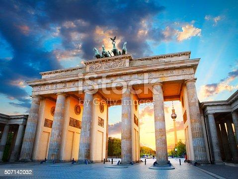 Brandenburg Gate and the TV tower at Pariser Platz in Berlin in sunset light