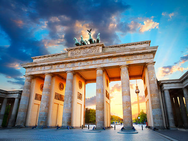 Brandenburg Gate and the TV tower in Berlin Brandenburg Gate and the TV tower at Pariser Platz in Berlin in sunset light berlin stock pictures, royalty-free photos & images