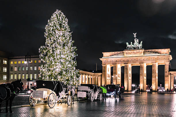 Brandenburg Gate at christimas in Berlin, Germany Photo of Brandenburg Gate at christimas in Berlin, Germany berlin stock pictures, royalty-free photos & images