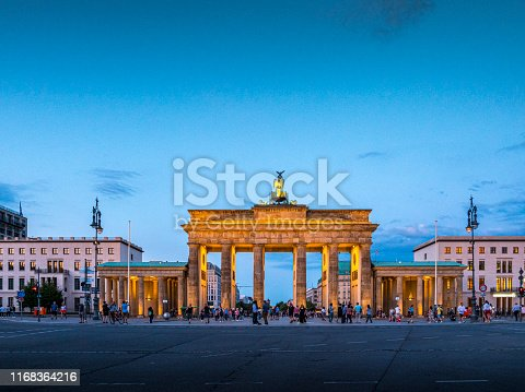 Berlin cityscape at sunset - Brandenburg Gate with dramatic sky