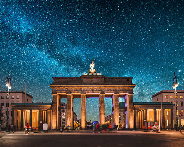 Brandenburg Gate, Berlin Brandenburg Gate in Berlin, Germany, at night, under a beautiful starry sky berlin stock pictures, royalty-free photos & images