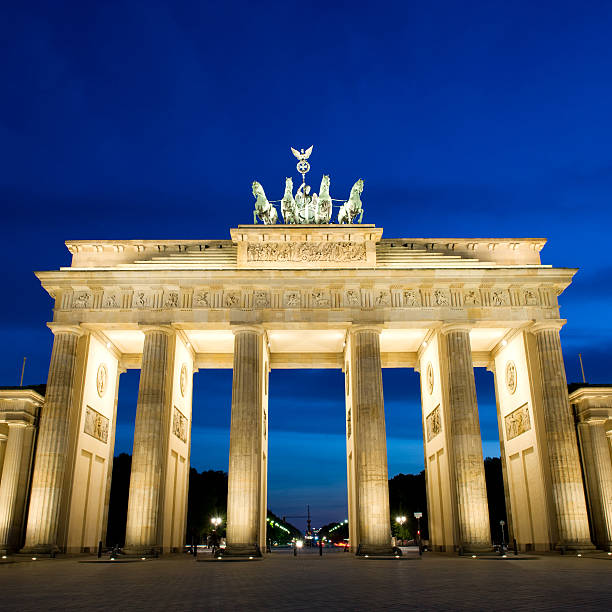 Brandenburg Gate in Berlin at night with vibrant colour stock photo