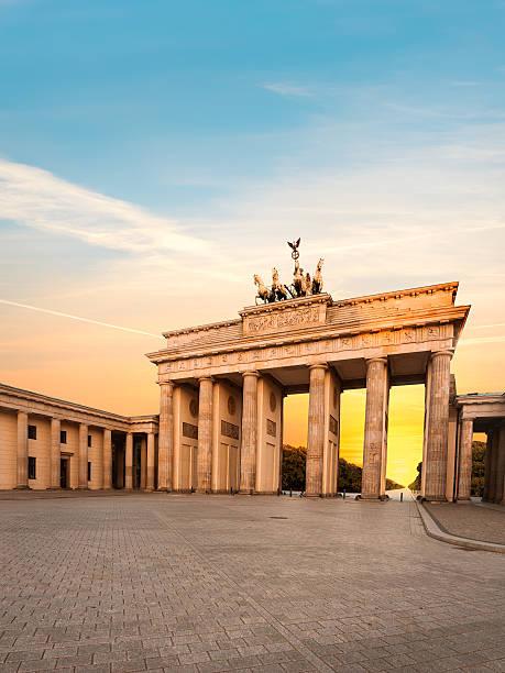 Brandenburg Gate in Berlin, Germany at sunset stock photo
