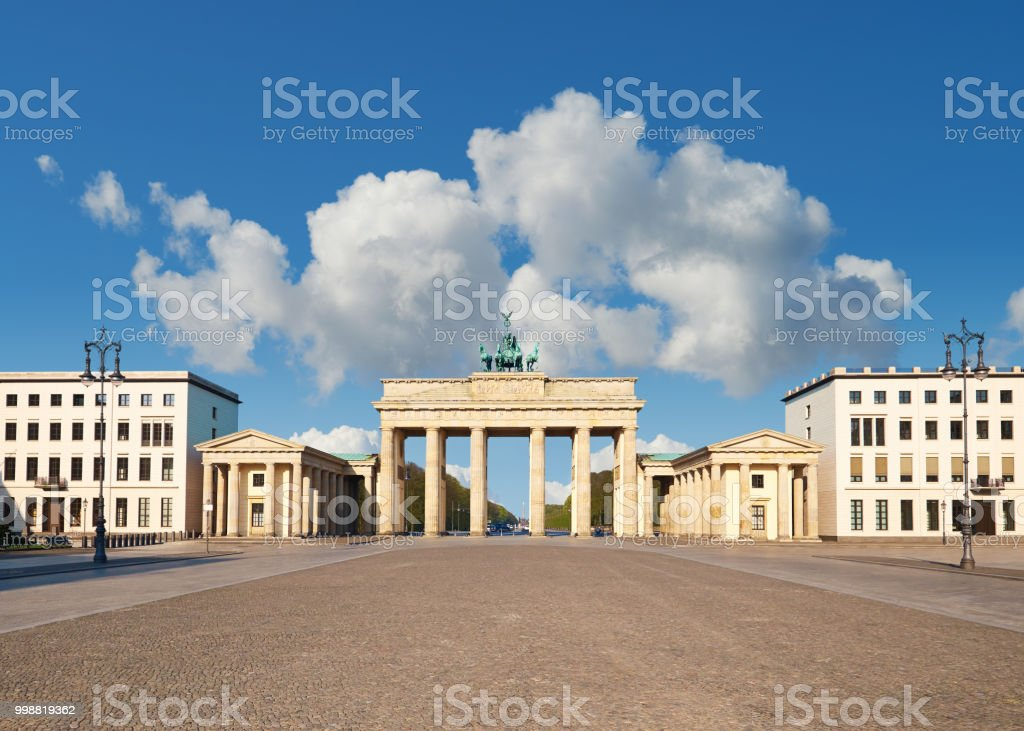 Brandenburg Gate in Berlin, Germany, on a bright day stock photo