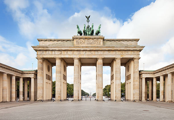 Brandenburg Gate, in Berlin, Germany The world famous Brandenburger Tor (Brandenburg gate) in Berlin (Germany) at daylight. berlin stock pictures, royalty-free photos & images