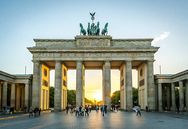 Brandenburg Gate in Berlin The famous Brandenburg Gate in Berlin, Germany, at sunset berlin stock pictures, royalty-free photos & images