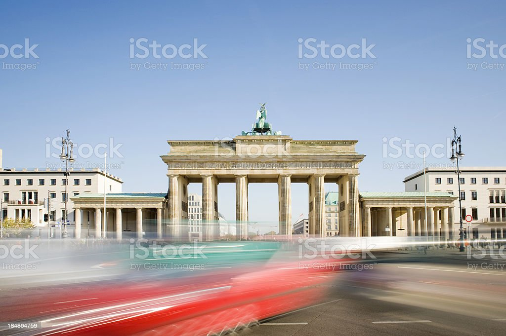 Brandenburg Gate in Berlin with Passing Traffic Germany royalty-free stock photo