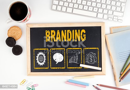 istock Branding concept. Chalkboard on white office desk 649214584