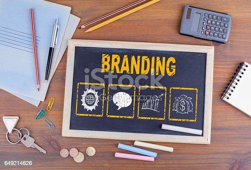 istock Branding concept. Chalkboard on wooden office desk 649214626
