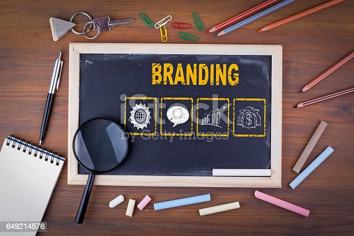 657955676 istock photo Branding concept. On a wooden table chalk board 649214576