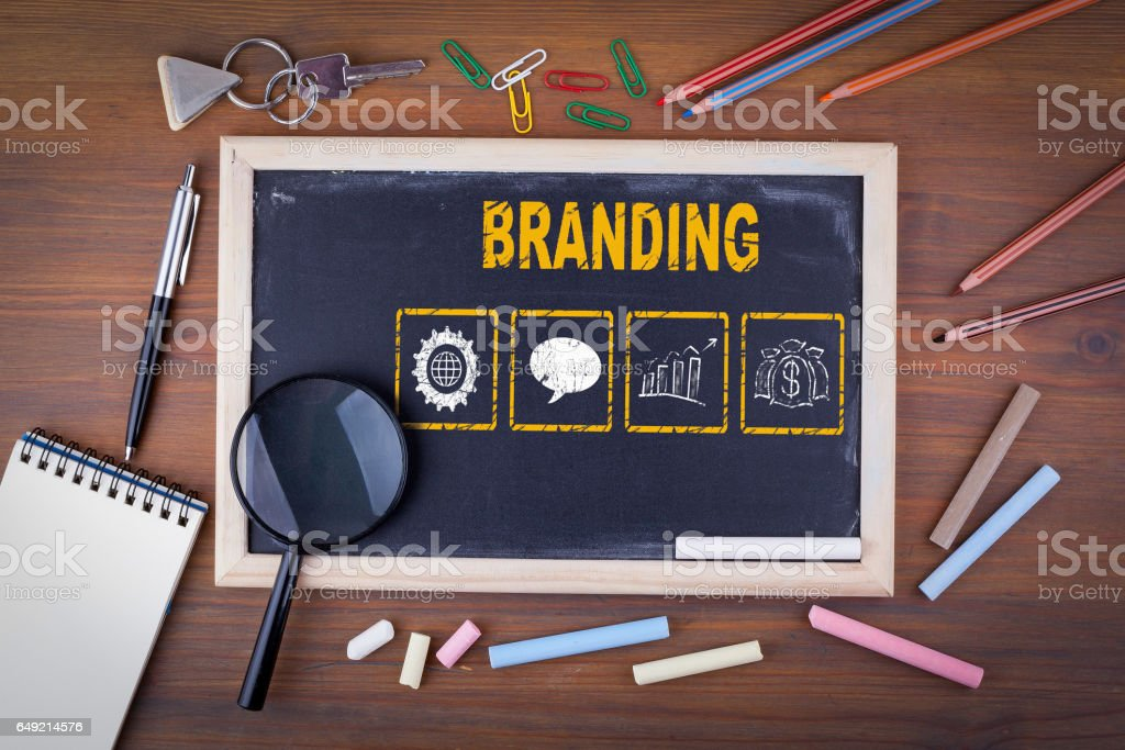 Branding concept. On a wooden table chalk board stock photo