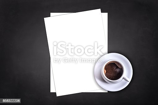 Blank letterhead and coffee cup on black table background. Blank branding template. Mock up for branding identity for placing your design. Top view.